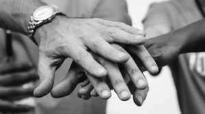 black and white photo of person s hands